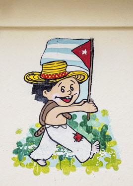 CUB2116AW Boy walking with Cuban Flag Mural Painting, Sancti Spiritus, Sancti Spiritus Province, Cuba