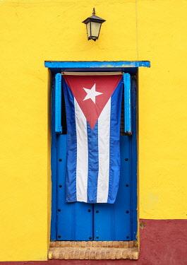 CUB2173AW Cuban Flag in Trinidad, Sancti Spiritus Province, Cuba