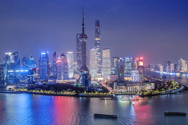 CH12163AW Asia, China, Shanghai municipality, Shanghai city, night time shot, showing the skyline of Pudong, with the world finance tower, the Shanghai tower, the Oriental Pearl Tower and the Huangpu river