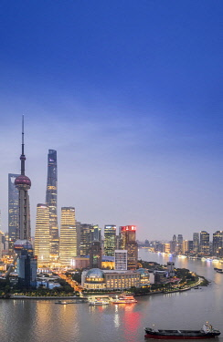 CH12165AW Asia, China, Shanghai municipality, Shanghai city, night time shot, showing the skyline of Pudong, with the world finance tower, the Shanghai tower, the Oriental Pearl Tower and the Huangpu river