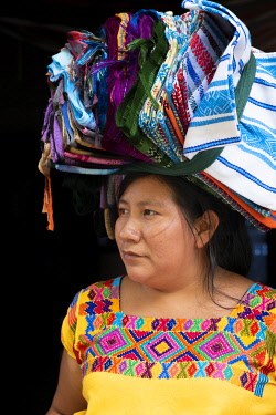 ELS0014AW Americas, Central America, El Salvador,  indigenous Mayan woman in a village market, wearing traditional dress