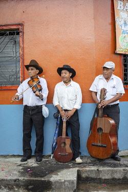 ELS0042AW Americas, Central America, El Salvador, mariachi musicians in a a village street