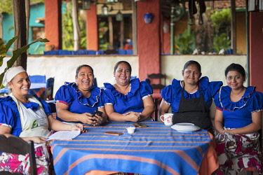 ELS0050AW Americas, Central America, El Salvador, Cuscatlan department, Suchitoto village, local Mayan women sitting at table