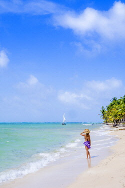 Americas, Central America, Nicaragua, South Caribbean Coast Autonomous Region, Corn Islands, Little Corn Island, Northern End beach, a young Caucasian woman on a pristine white-sand tropical beach (MR...