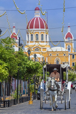 Americas, Central America, Nicaragua, Granada, view of the skyline showing a horse-drawn carriage with the neoclassical cathedral in the background