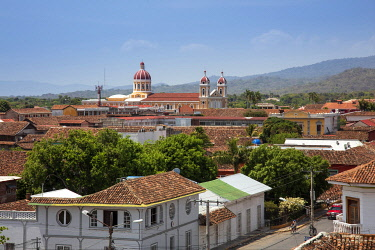 NIC0290AW Americas, Central America, Nicaragua, Granada, view of the skyline showing Spanish-colonial terracotta-roofed buildings and the neoclassical cathedral