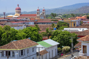 NIC0291AW Americas, Central America, Nicaragua, Granada, view of the skyline showing Spanish-colonial terracotta-roofed buildings and the neoclassical cathedral