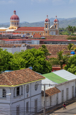 NIC0292AW Americas, Central America, Nicaragua, Granada, view of the skyline showing Spanish-colonial terracotta-roofed buildings and the neoclassical cathedral