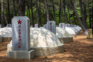 NKO0434 North Korea, Hoechang Province. Graves of fallen Chinese soldiers killed in the Korean War, within the Chinese People's Volunteers Cemetery, where Mao Anying, son of Mao Zedong, is also laid to rest.