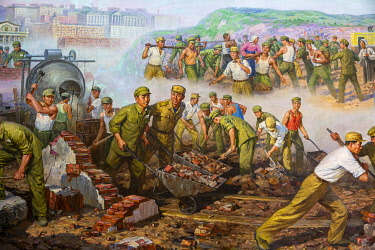 NKO0439 North Korea, Pyongyang. Paintings within the Sino-Korean Friendship Tower depicting Korean and Chinese soldiers working together to help reconstruct North Korea after the War.
