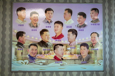 NKO0444 North Korea, Pyongyang. Hair styles as suggested by Kim Jong Un at a men's salon within the Munsu Water Park.