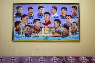 NKO0478 North Korea, Pyongyang. Suggested hair styles at a men's salon within the Changgwang Health Complex.