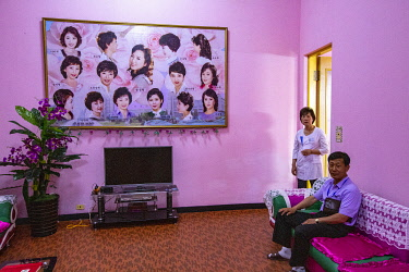 NKO0479 North Korea, Pyongyang. Suggested hair styles at a ladies salon within the Changgwang Health Complex.