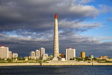 NKO0499 North Korea, Pyongyang. View of the Juche Tower across the Taedong River.