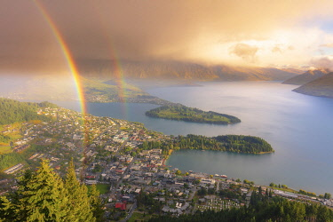 NZ10005AWRF View of Queenstown and Wakatipu lake with a double rainbow at sunset, Otago, South Island, New Zealand