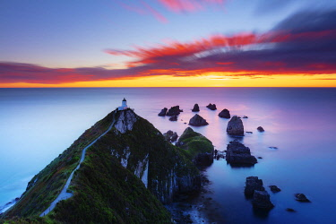 NZ9871AW Elevated view of Nugget Point lighthouse in the Catlins national park, Otago, South Island, New Zealand