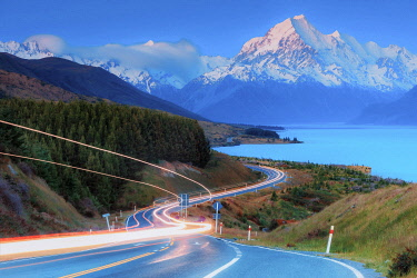NZ9903AW Highway running aong Pukaki lake and leading to Mount Cook (Aoraki), Canterbury, South Island, New Zealand
