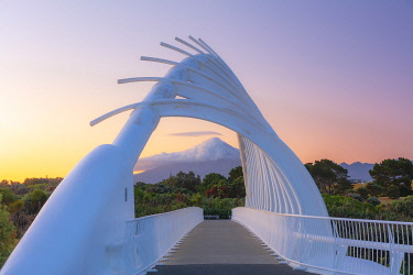 NZ9918AW View of the Taranaki volcano in New Zealand through a modern bridge in New Plymouth at sunrise