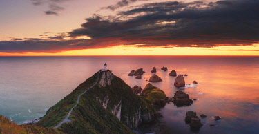 NZ9954AW Elevated view of Nugget Point lighthouse in the Catlins national park, Otago, South Island, New Zealand