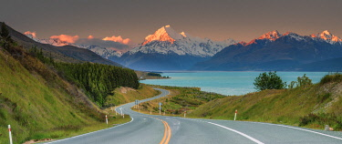 Highway running aong Pukaki lake and leading to Mount Cook (Aoraki), Canterbury, South Island, New Zealand