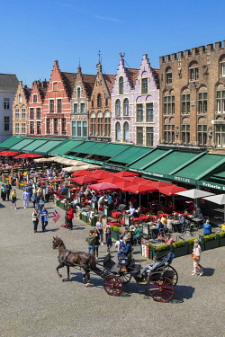 HMS3527789 Belgium, Western Flanders, Bruges, historical centre listed as World Heritage by UNESCO, Grand Place, restaurant terraces and gabled house