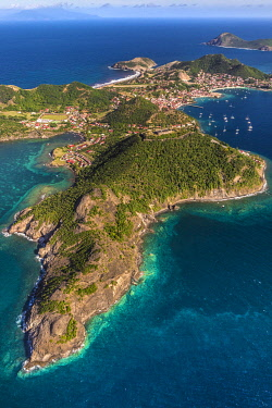 HMS3569938 Guadeloupe, Les Saintes, Terre de Haut, the bay of the town of Terre de Haut, listed by UNESCO among the 10 most beautiful bays in the world, Dominica island in background (aerial view)