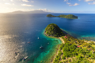 Guadeloupe, Les Saintes, Terre de Haut, the bay of the town of Terre de Haut, listed by UNESCO among the 10 most beautiful bays in the world, here the Pain de Sucre, Basse Terre in background (aerial...