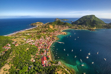 HMS3569956 Guadeloupe, Les Saintes, Terre de Haut, the bay of the town of Terre de Haut, listed by UNESCO among the 10 most beautiful bays in the world, Dominica island in background (aerial view)