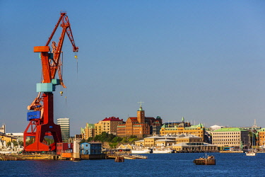 HMS3567673 Sweden, Vastra Gotaland, Goteborg (Gothenburg), the former shipyards of Lundbyvassen, buildings of the company ASECO on Packhusplatsen facing the harbor and Kvarnberget and his clock
