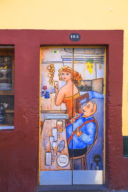 PT04162 Portugal, Madeira, Funchal, Painted doors in Rue Da Santa Maria in the old town
