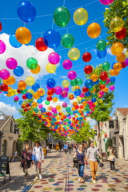 HMS3566120 France, Paris, Bercy village, Patricia Cunha's multicolored balloons float above the Cour St Emilion in Paris from June 8 to August 31, 2019