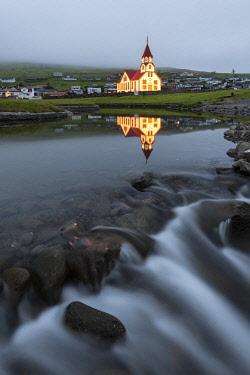 CLKAB119536 Church and river of Sandavagur at dusk, Vagar island, Faroe Islands, Denmark, Europe