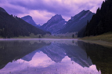 CLKFB114757 Mountains are reflected in the Samtisersee at sunrise,Canton of Appenzell, Alpstein, Switzerland, Europe