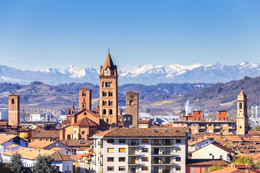 CLKFB122054 Skyline of Alba with Alps in the background. Village of Alba, Piedmont, Italy, Europe.