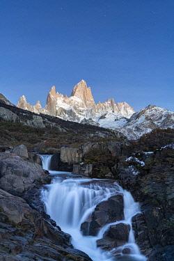 CLKFV118126 Secret waterfall and Fitz Roy at dusk, El Chalten, Santa Cruz province, Argentina.