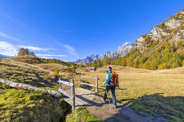 CLKGP119914 A girl is walking near Alp Crampiolo in autumn season, Alpe Veglia and Alpe Devero Natural Park (Alpe Devero, Baceno, Antigorio Valley, Verbano Cusio Ossola province, Piedmont, Italy, Europe) (MR)