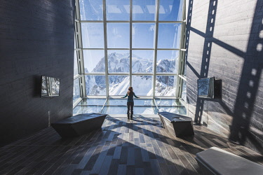 CLKLC118954 A girl watching the top of Mont Blanc from Skyway  cableway station, Punta Helbronner, Aosta, Aosta valley, Italy, Europe  (MR)