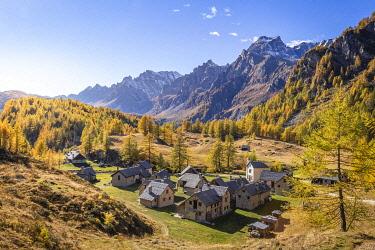 CLKLC120452 Little mountain village, Crampiolo, during autumn, Cervandone peak and Boccareccio peak in the background, Alpe Veglia and Alpe Devero Natural Park, Baceno, Verbano Cusio Ossola, Piedimont, Italy, Eur...