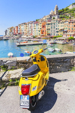 ITA15058AW Yellow Vespa scooter parked near harbour, Portovenere, La Spezia district, Liguria, Italy