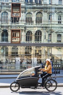 HMS3524478 France, Rhone, Lyon, historic district listed as a UNESCO World Heritage site, Cordeliers square, reflection of the Palais de la Bourse de Lyon in the window of Monoprix