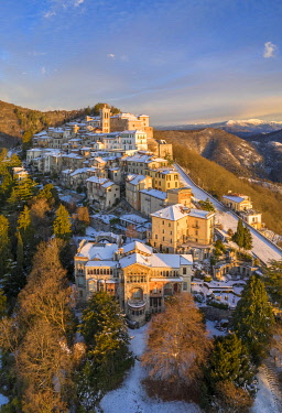 CLKMC122201 Aerial view of Santa Maria del Monte and the chapels of the sacred way during a winter sunrise. Sacro Monte di Varese, Varese, Lombardy, Italy.