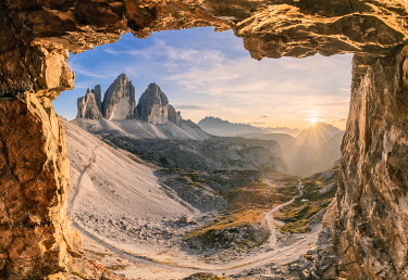 CLKMG119737 glimpse on the Tre Cime di Lavaredo from a war cave, sexten dolomites, south tyrol, italy europe