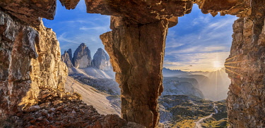 CLKMG119742 glimpse on the Tre Cime di Lavaredo from a war cave, sexten dolomites, south tyrol, italy europe