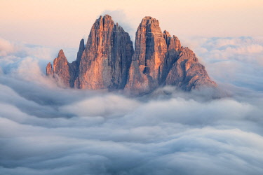 CLKMG120118 Tre Cime di Lavaredo emerging from the clouds, Sexten Dolomites, South Tyrol, Bolzano, Italy, Europe