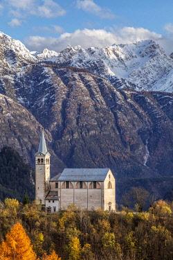 CLKMG120669 Ancient church of  Valle di Cadore and snowcapped Dolomiti di Oltrepiave on the background, Belluno, Veneto, Italy, Europe