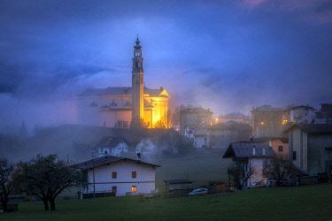 CLKMG120971 Domegge di Cadore at dusk with the church of San Giorgio martire, Cadore, Belluno, Veneto, Italy