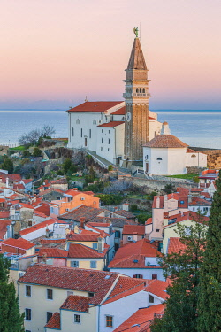 CLKMG121310 Twilight on the historic town of Piran with the church of St. George, Primorska, Istria, Slovenia