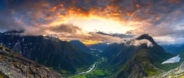 CLKRM118425 Sunset over the majestic Troll Wall and Venjesdalen mountain seen from Romsdalseggen Ridge, Andalsnes, More og Romsdal, Norway