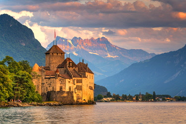 CLKRM118454 Chillon Castle (Chateau de Chillon) on shores of Lake Geneva with the Alps in background, Montreux, Vaud, Switzerland