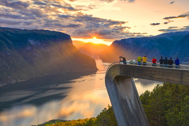 CLKRM118511 People photographing sunset on the fjord from Stegastein viewpoint, aerial view, Aurlandsfjord, Sogn og Fjordane county, Norway
